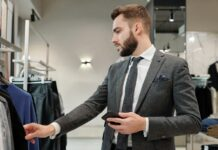 Businessman choosing clothes in store